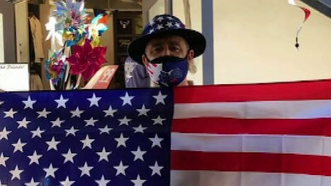 Store owner on giving away flags, masks