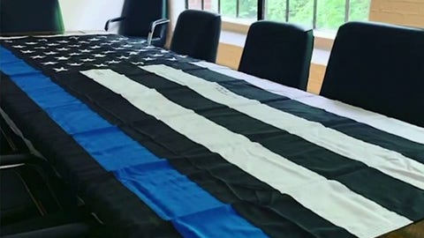 Media company doubles down on pro-police flag