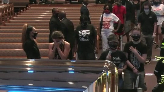 Mourners pay respects to George Floyd at public viewing in Texas