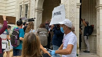 Protesters stage early morning noise demonstration at Postmaster General's home: 'No Joy for DeJoy'