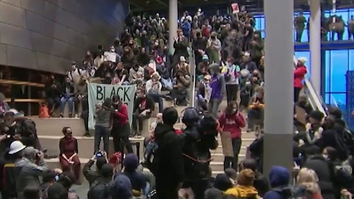 Protesters take over Seattle City Hall with calls to defund police department