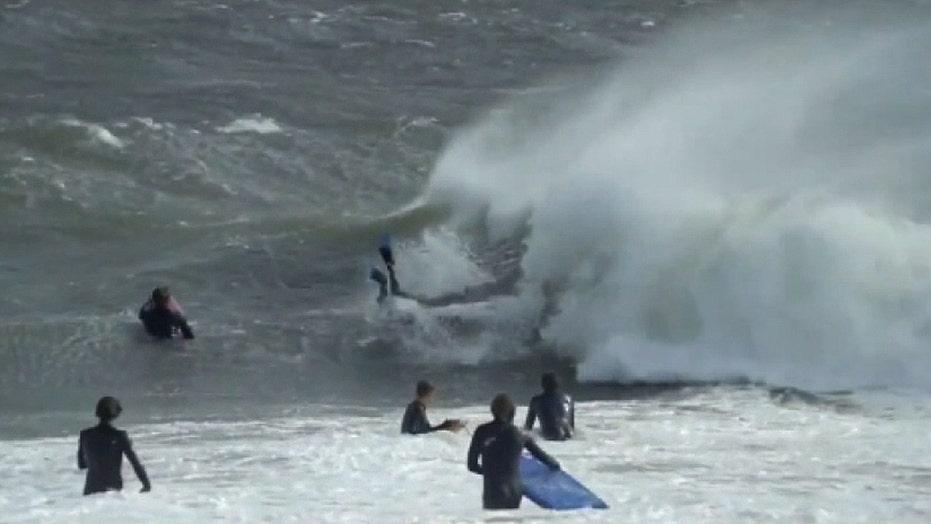 Surfers brave huge waves off Sydney coast despite warnings of hazardous conditions