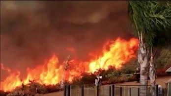 Firefighters work around clock battling dozens of wildfires in Western US