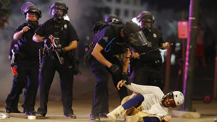 Police clash with George Floyd protesters in demonstrations across America