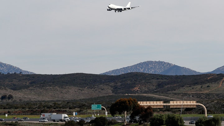 Plane carrying evacuees from the coronavirus outbreak in China lands at Marine Corps Station Miramar