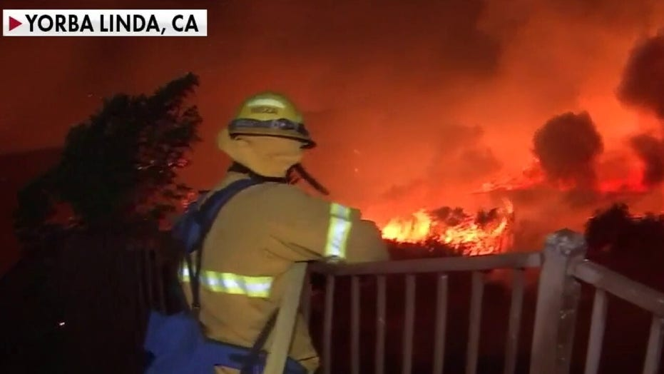 Fast-moving wildfires force evacuations in Southern California