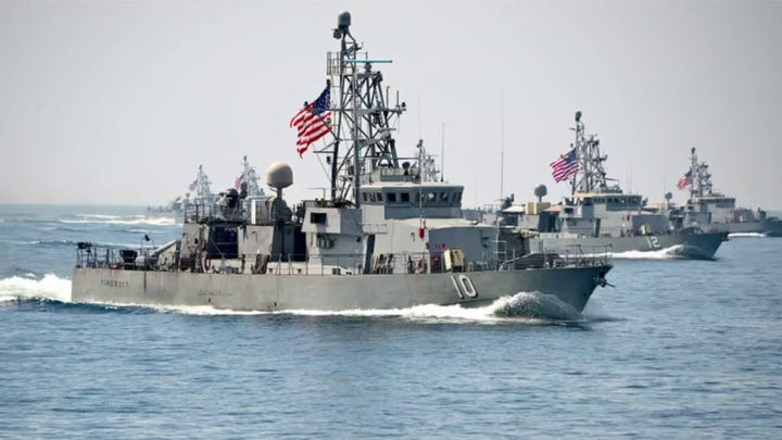 US Navy fires warning shots at three Iranian vessels