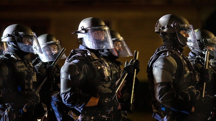 One dead after clash between protesters and Trump supporters in Portland