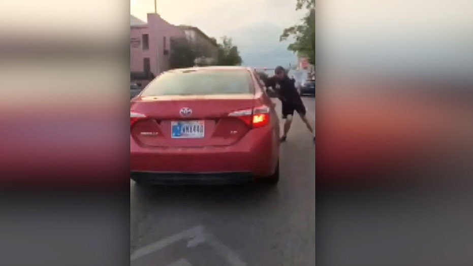 Car drives through anti-racism protest in Bloomington, Indiana<br>
