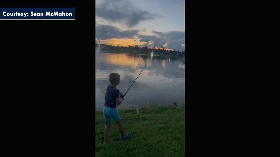 Alligator steals child's fishing rod in shocking video