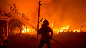 California firefighters battle fast-moving wildfire near Los Angeles