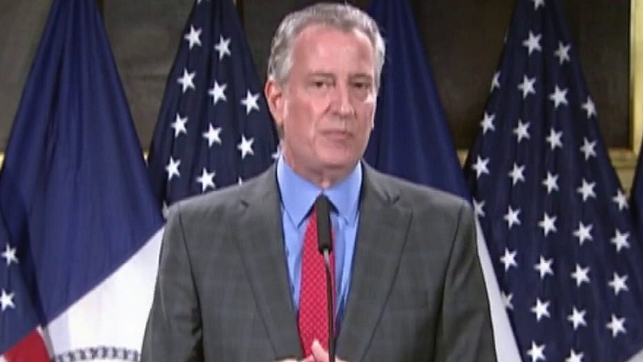 Mayor Bill de Blasio under fire over handling of protests in New York City