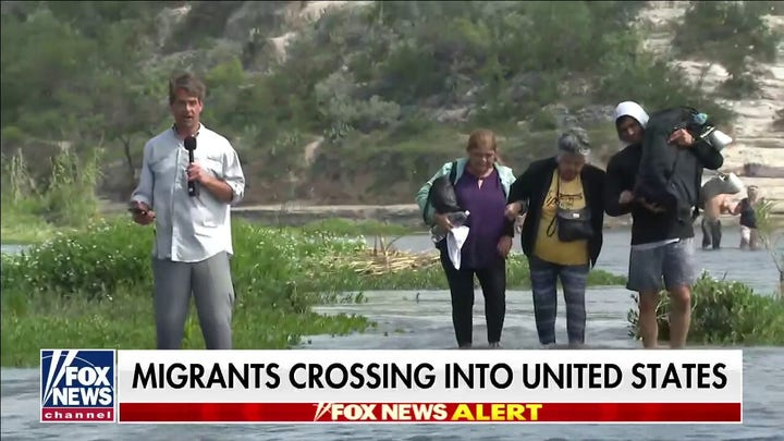 Migrants cross into the US as Fox News reports from border