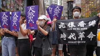 Protesters swarm Hong Kong shopping district in response to proposed security law
