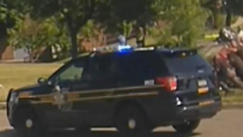 Harrowing Michigan dashcam video shows deputies lifting car off woman to save her life
