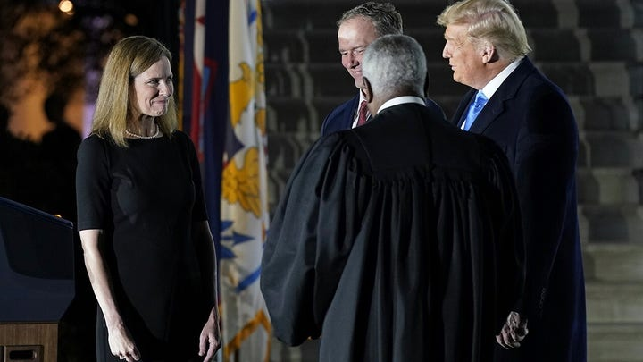 Justice Clarence Thomas administers constitutional oath to ACB