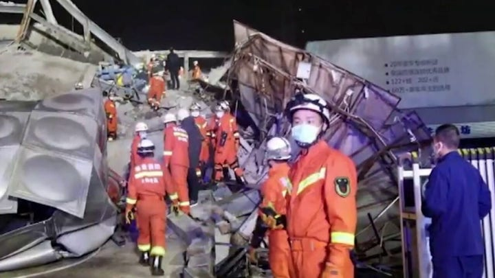 Rescue workers in China scramble to save people trapped in collapsed hotel set up for coronavirus containment