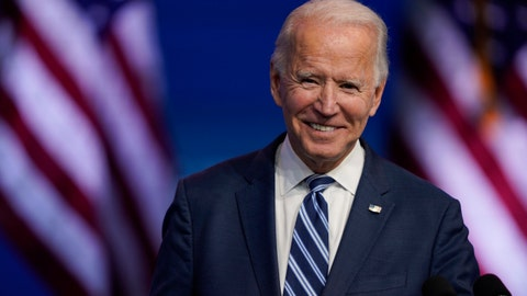 Should President-elect Biden wait before discussing foreign policy with world leaders?