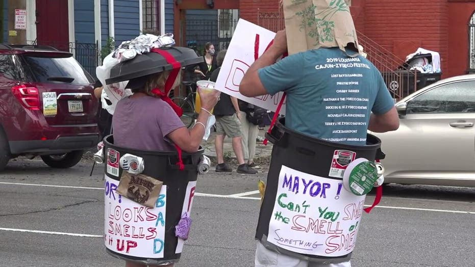 New Orleans residents hold 'trash parade' protest after garbage pickup delayed 3 weeks post Hurricane Ida
