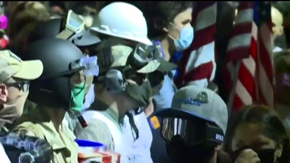 Protesters throw bottles at Portland police