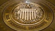 Fed holds rates near zero