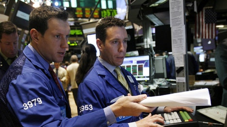 Wall Street opened lower on Friday, suggesting investors were wary of taking big positions into the weekend after days of tumultuous trading.