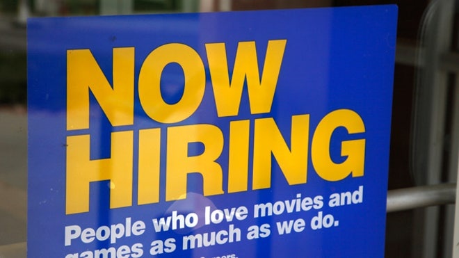 Help Wanted Sign at Blockbuster Store