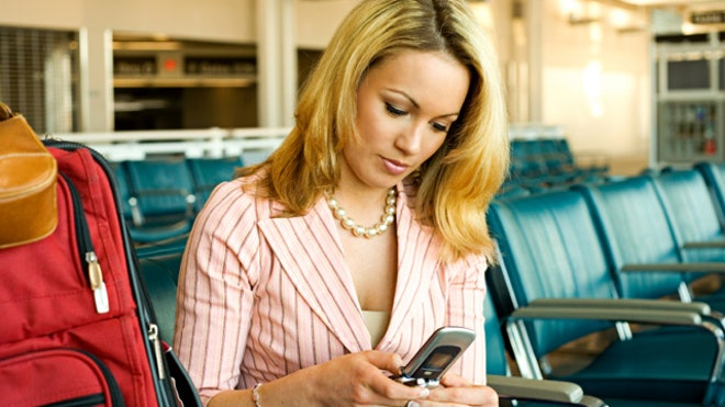 Woman Texting Airport Cell Phone