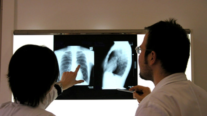 Health Care Doctors Looking at Xrays