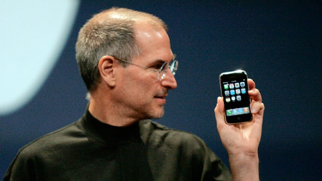 Apple CEO Steve Jobs Looks at iPhone