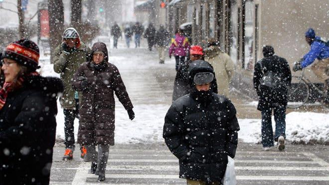 Winter Coats Pedestrians Walking, Reuters
