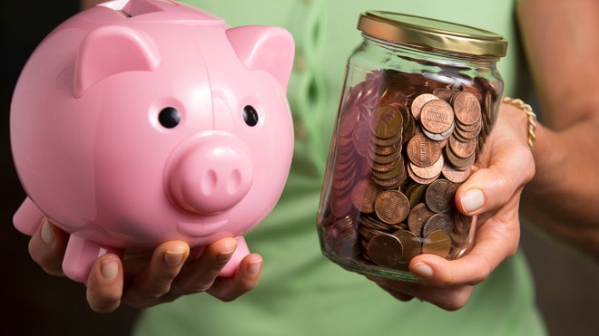 Hands holding piggy bank and jar of pennies