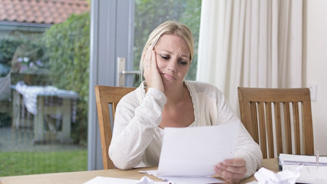 Stressed woman planning finances, bills, and debt