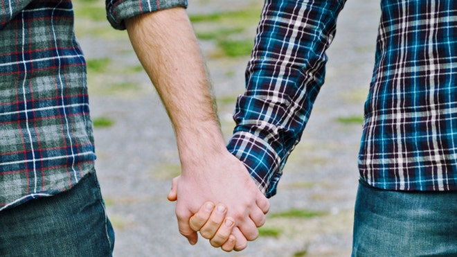Gay couple holding hands istock.jpg