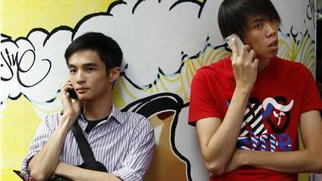 Asian Men on Phones Reuters