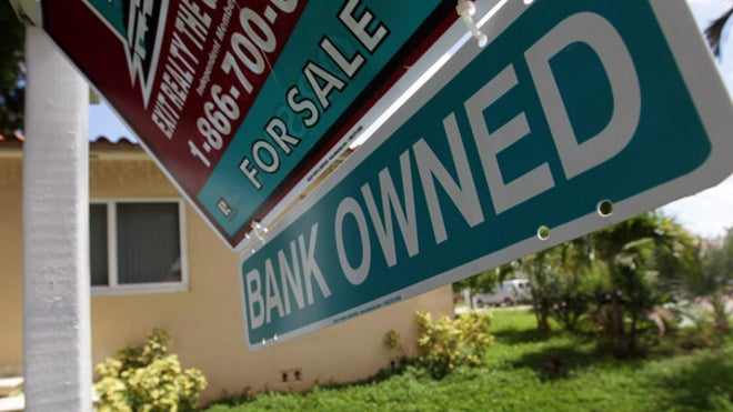 Foreclosed home bank owned sign
