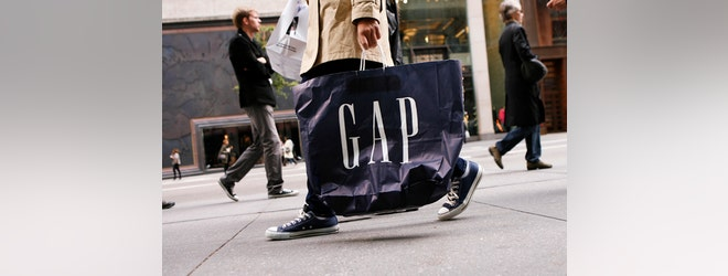 Gap offered a muted earnings forecast for the year, blaming the impact of the stronger dollar and delayed shippings at West Coast ports. The retailer also announced plans to bring back a company veteran to help revive its struggling namesake stores, where sales at its established stores declined during the holiday quarter.