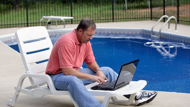 Man-Laptop-Pool-Outside