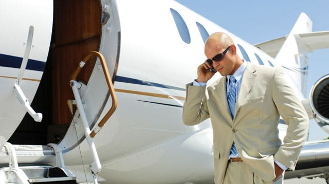 Business Man on Phone Boarding Private Jet