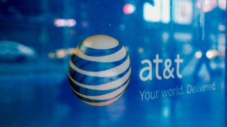 ATT reported a % drop in second-quarter earnings, even though the telecom giant's wireless business added more customers than expected.