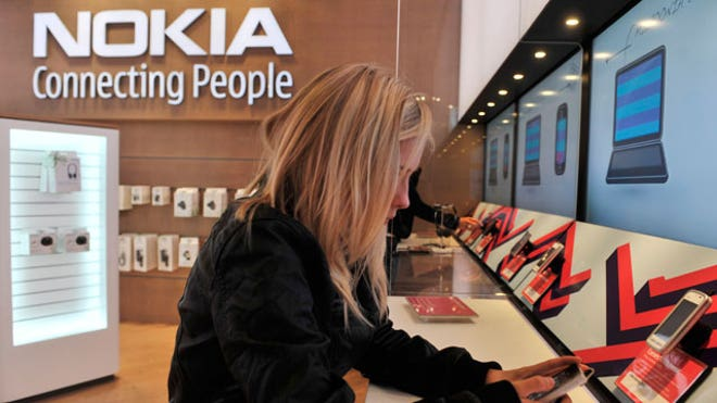 Customer Tests Nokia Phone at Flagship Store