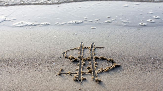 Dollar-Sign-Drawn-Sand-Beach