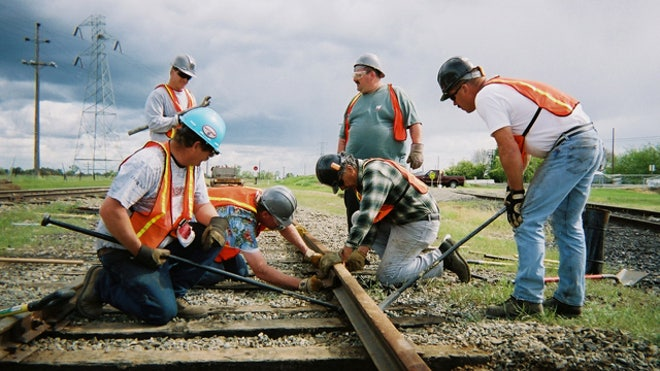 Government-Contractors-Working-Train-Rail-Stimulus