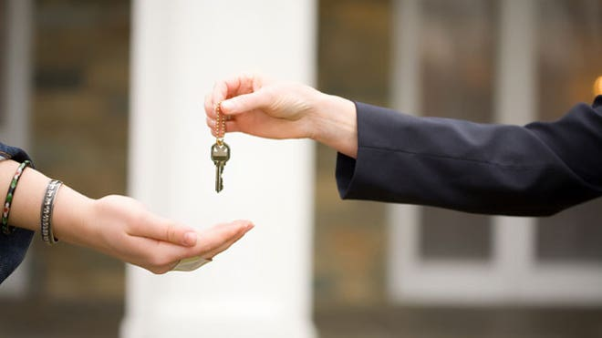 Keys-Handed-Off-Home-Auto-Sale