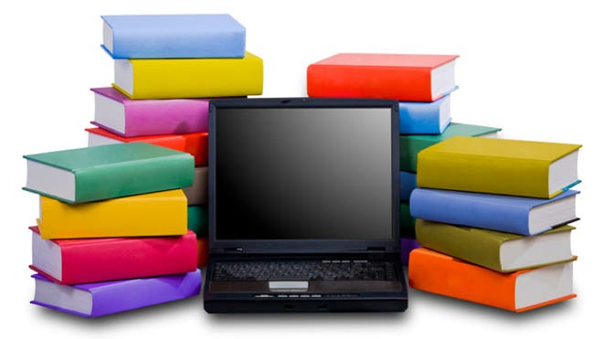 Laptop-Books-Stacked-Behind