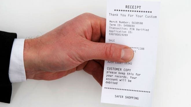 Man-Holding-Receipt-Purchase