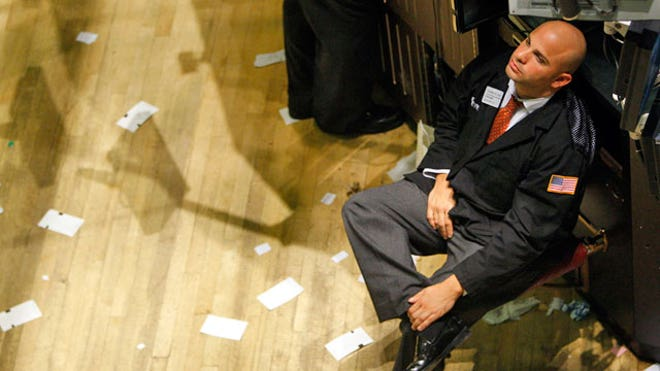 NYSE-Trader-051-Sits-After-Long-Day