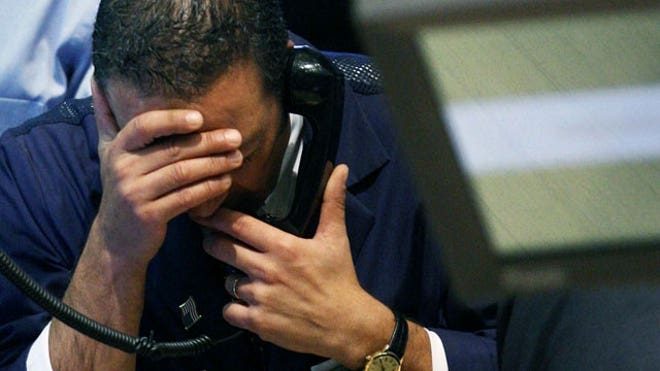 NYSE-Trader-069-on-Phone-Upset