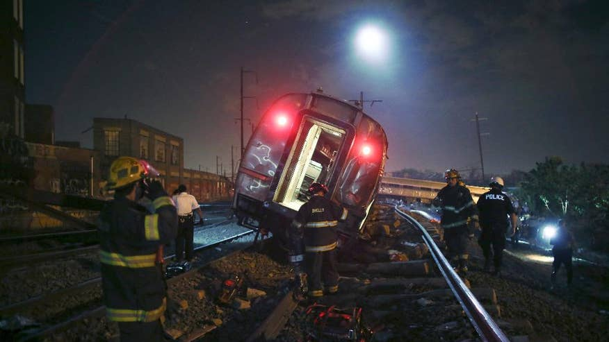 FILE – In this May 12, 2105 file photo, emergency personnel work the scene of a deadly train wreck in Philadelphia. An Amtrak train headed to New York City derailed and tipped in Philadelphia. Despite several years of horrific oil train wrecks and record car and truck recalls, congressional Republicans have decided that the auto and railroad industries suffer from too much safety regulation, not too little. (AP Photo/ Joseph Kaczmarek, File) (The Associated Press)