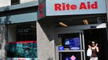 Rite Aid Corp, the third-largest U.S. drugstore chain, cut its full-year profit forecast for the second time, citing lower margins in its pharmacy business, sending its shares down  percent in premarket trading.